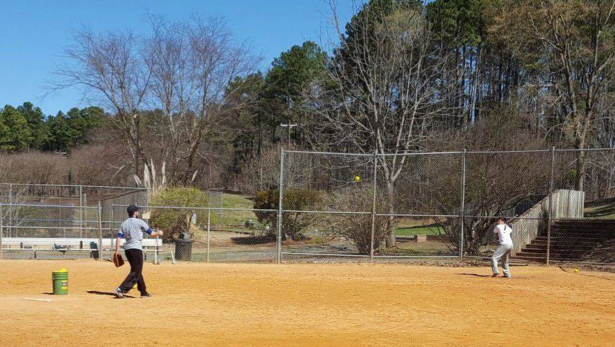 Action shot of a pitch being thrown during Spring softball practice